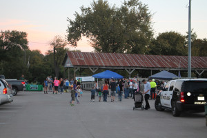 Crowds hang out with emergency services personnel at the Onion Shed Oct. 6.