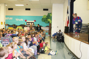 MoMo the clown (Monica Love) entertains students at Tatum Elementary School with guitar riffs to fire and life safety songs.