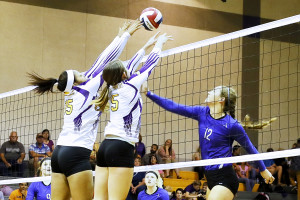 Farmersville's Arianna Brooks (15) and Chloe Wall (5) team up to block a shot by Van Alstyne's Ellie Perkins at the net during a District 13-3A match.