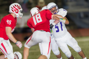 Reid Brown blocks out a Pottsboro defender during the District 5-3A Div. I opener last Friday at Jim Henderson Field.