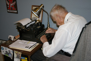 Wayne Spraggings, of Murphy, types up a story on his trusty type writer in his office.