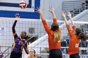 J'Kaylee Clark faces opposition at the net by Lauren Almuerte (#10) and Alexis Newell (#11)