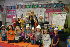 Mrs. Cross' Kindergarten class shows off their pilgrim and indian outfits prior to the Thanksgiving feast.