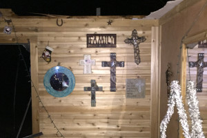 A wall of crosses sits untouched in the Peters house after the home was demolished by a tornado Dec. 26 in Farmersville.