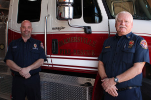 Newly hired full-time Farmersville firefighter Jason Brisby stands with Fire Chief Kim Morris. Brisby is the first paid firefighter to be hired by the city of Farmersville.