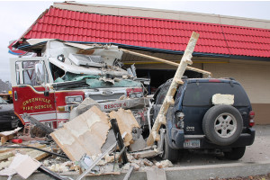 Jon Marie Russmann, driving the jeep, got quite the scare when a Pierce fire engine crashed into the Dairy Queen Jan. 20.