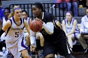 Alexis Bee puts defensive pressure on a Whitewright Tiger near the midcourt line in district competition.