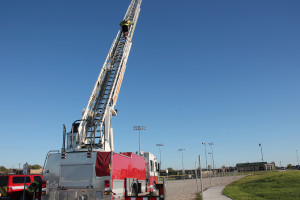 Firefighter/EMT Zac Sydney climbs the Quint's 77 foot ladder for the department's physical agility test.