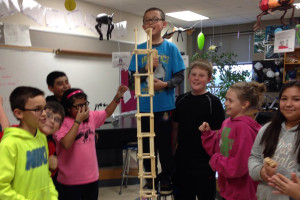 Ashley Holland's fifth grade class builds a tower in the science lab at the Intermediate School. See this photo and more including the fourth six weeks' honor roll page inside this week's edition!