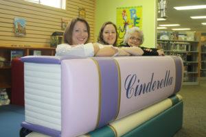 Library staff members include Audrey Rubadue, Trisha Dowell and Bonnie Hegler.