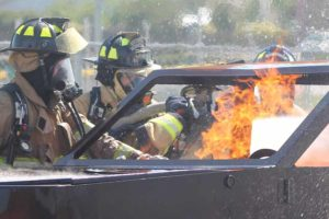 Farmersville firefighters Aaron Pollard, Mike Sullivan and Angie Rios practice extinguishing a car fire along with a Collin College fire instructor April 23. Farmersville Fire Department, Josephine Fire/Rescue and Nevada Fire Department participated at the training which was set up at the Farmersville Junior High School.