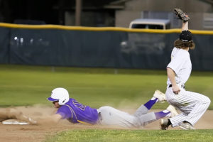 Farmersville's Jason Luke slides head first into second base as the throw from home sails into centerfield at Whitewright in District 13-3A action. For the full story and additional photos see this week's Sports. Victor Tapia/The Farmersville Times