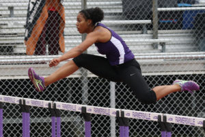 Farmersville's Karlee Young makes her way over the hurdle during the 100-meter hurdle at the April 13-14 District 13-3A meet at Fightin' Farmer Stadium. For the full story and additional photos see this week's Sports.