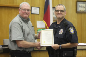 Mayor Joe Helmberger recently presented a proclaimation to Police Chief Mike Sullivan who completed his 30th year of being in law enforcement. Sullivan has worked for Dallas County, Heath and Desoto and also is a graduate of the FBI National Academy, the Law Enforcement Management Institute of Texas and has his Masters of Science in Criminal Justice Leadership.