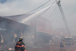 Heavy smoke permeated the air during a multiple buildings structure fire in downtown Farmersville.