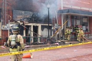 Multiple fire departments work together to save buildings in the downtown Farmersville area.
