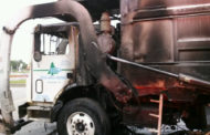Trash truck catches fire at Dairy Queen