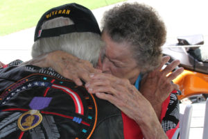 Nadine Murphy Lokey, Audie Murphy's sister, hugs Medal of Honor recipient Bob O' Malley during last year's Audie Murphy Day. Mr. O'Malley was the first Marine to receive the Medal of Honor in the Vietnam War.