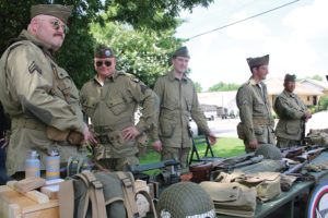 Members of the living history group, Able Company 1st Battalion, 502 parachute infantry regiment show off a display at Audie Murphy Day June 18. The group educates the public about what World War II was like.
