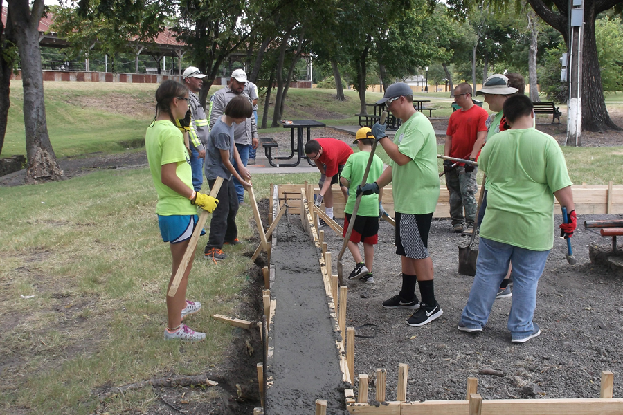 Scouting out safety: Eagle Scout project makes sliding safer in Farmersville City Park
