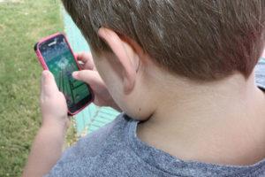 Clayton Jenkins,8, prepares to capture a Pokemon at a Poke Stop.