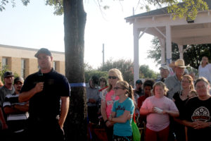 Farmersville Fire Captain Chris Calverley addresses crowds gathered downtown July 13 for a prayer vigil to pray over first responders.