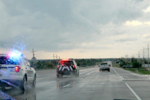 Amidst heavy rain, a pursuit for a stolen vehicle occurs down Hwy. 380.