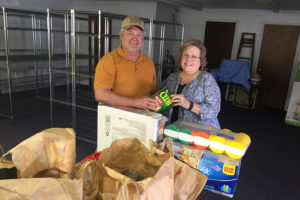 The Farmersville Rotary Club recently collected donations for the Farmersville Community Outreach Food Pantry. From left is Rotarian Charlie Whitaker and Pantry volunteer Shirley Weldon.