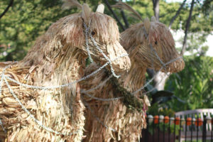 Corn husk horses are showcased as part of the fairy tale settings at the arboretum.