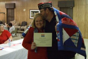 Lynn Hendrex, Quilt of Valor Chairperson from the Farmersville Quilt Guild, gets a thank you from Farmersville VFW Post 7426 member Darrell Moore. Moore's quilt is put together from blocks made by local guild members.