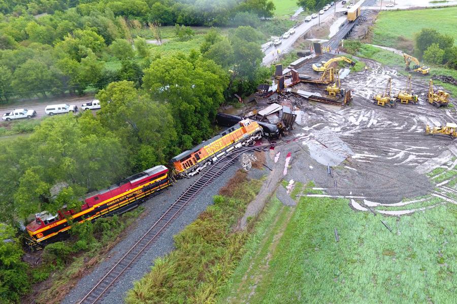 Deluge creates closures, train derailment